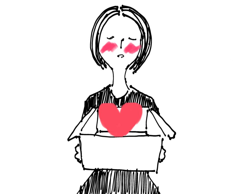 箱にハートを入れる女性のイメージ
